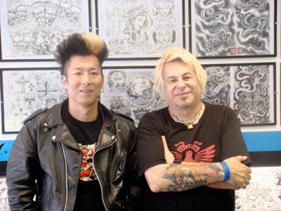 Jet & Charlie at Skunx Tattoo shop, London, 2008. Click on the photo to visit their website.