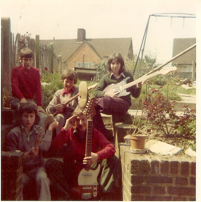 Nuclear Hurricane - a break from rehearsals, my parents' garden, 1973. Front row – Paul Coe (L), Jon (R). Back row - Alan, the roadie (L), John (middle) and myself (L). Click image to enlarge.