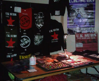 Merch desk with Japanese relief fund box - all photos by Jet - click to enlarge